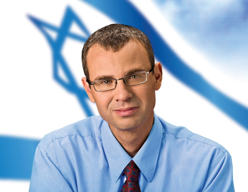 Likud MK Yariv Levin, pictured, has been the main proponent of a bill that allows the Israeli government to legally recognize Arab Christians as a separately national identity. That bill has now passed in the Knesset Credit: Reuven Kapuchinski.
