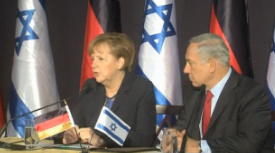 German Chancellor Angela Merkel in a joint press conference with Israeli Prime Minister Benjamin Netanyahu on Tuesday. Credit: Israel Hayom video screenshot.
