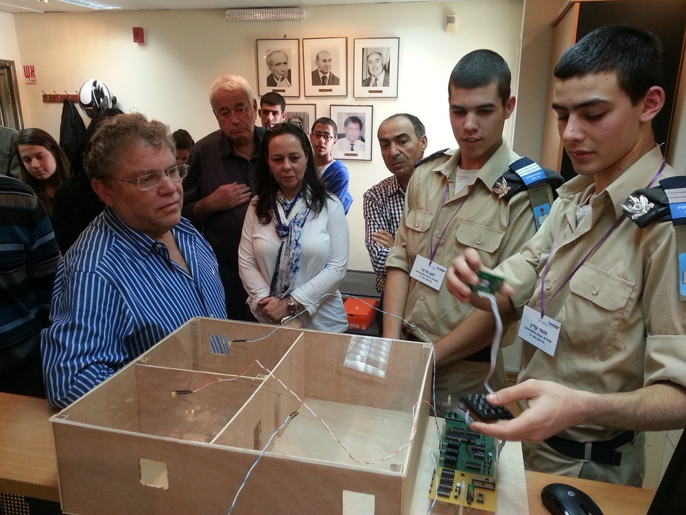 Click photo to download. Caption: Zvi Peleg (far left), director general of the Israel Sci-Tech Schools Network, is pictured with students of the Sci-Tech network's program in collaboration with the Israeli Air Force in Kfar Saba, Israel. Credit: Israel Sci-Tech Schools Network.