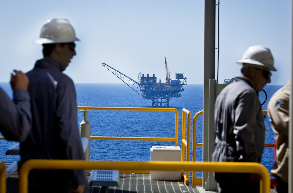 Click photo to download. Caption: Workers seen at the Tamar gas field off the northern coast of Israel. Credit: Moshe Shai/Flash90.