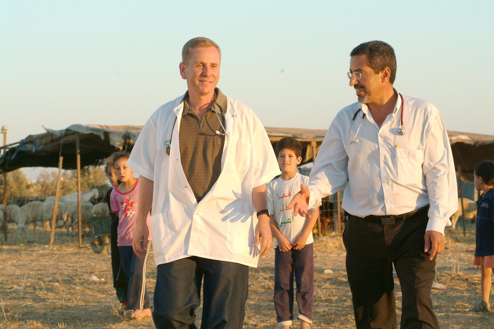 Click photo to download. Caption: Dr. Ohad Birk (pictured in front, on the left) working with Bedouin. Birk has announced the discovery of a genetic mutation in Moroccan Jews that leads to a crippling diseasehe is calling PCCA2.Credit: Dani Machlis.