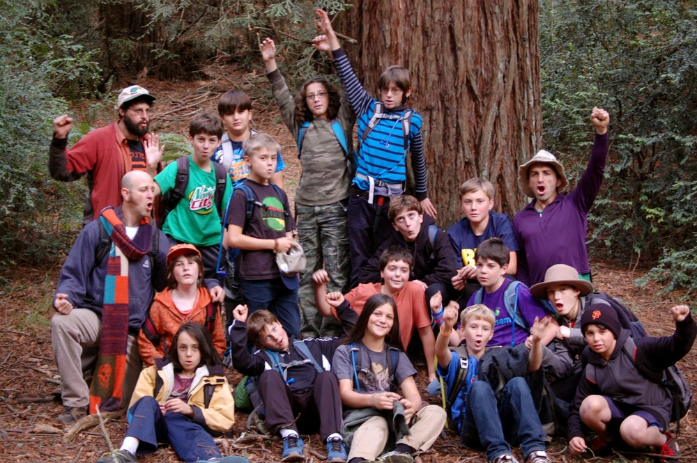 "Click photo to download. Caption: A group from Wilderness Torah's ""B'naiture"" program, which infuses the bar/bat mitzvah experience with nature, in the California Redwoods in 2013. Credit: Courtesy of Wilderness Torah."