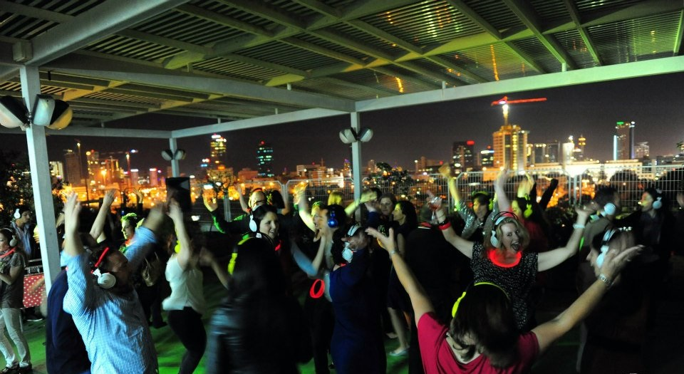 "Click photo to download. Caption: A ""silent disco"" on the roof of the Tel Aviv-based Reuth Medical Center for more than 180 young adults from seven different countries, arranged last year by Reuth's Young Leadership Division. Credit: Reuth."