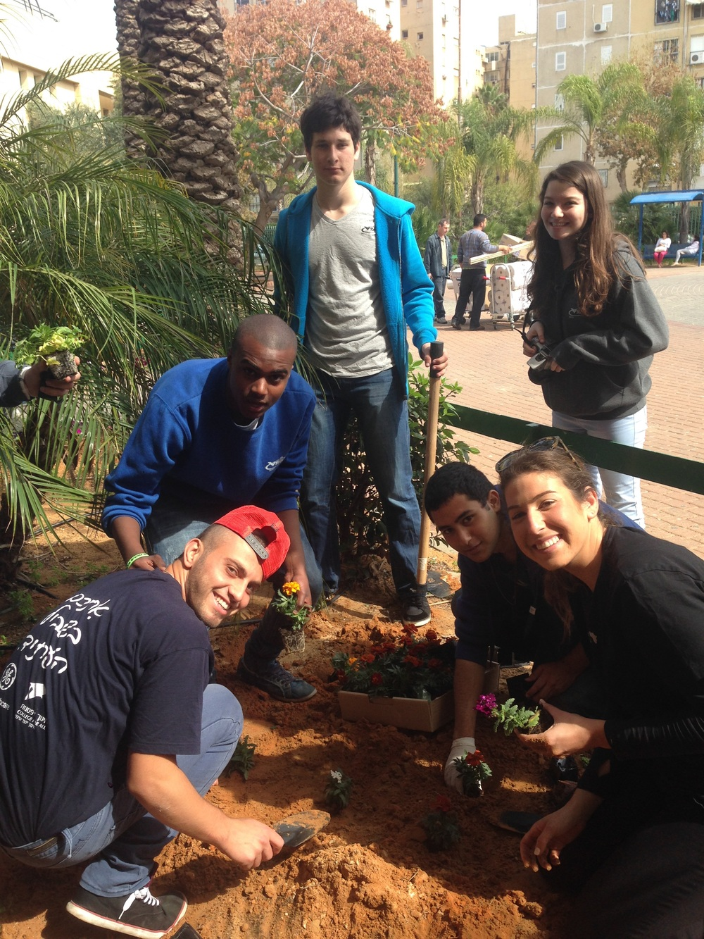 Innovation: Africa's Israel team cleans up a community park with students from the Ort Guttman High School in Netanya. Credit: Innovation: Africa.