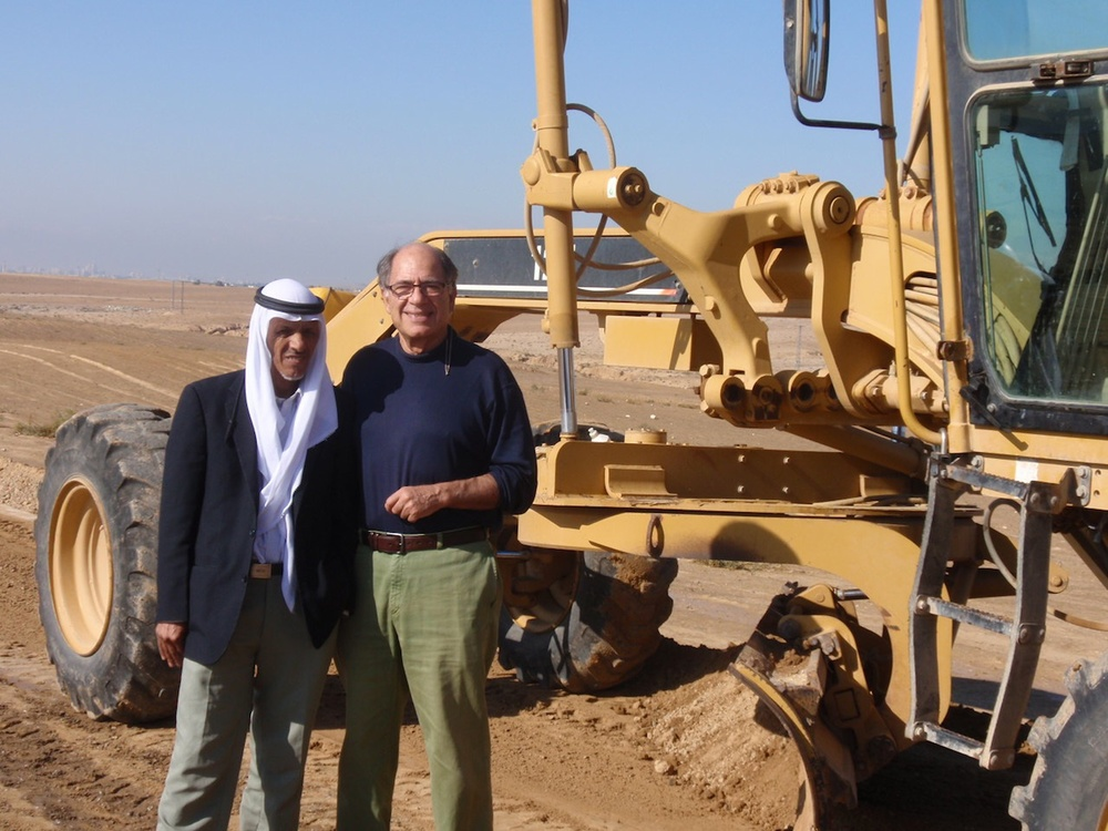 Click photo to download. Caption: Dr. Michael Ben-Eli, founder of the Sustainability Laboratory, and Wadi Attir team member Ali Alhawashleh (left) with earth-moving equipment from Keren Kayemeth LeIsrael (Jewish National Fund). Credit: Courtesy Project Wadi Attir.