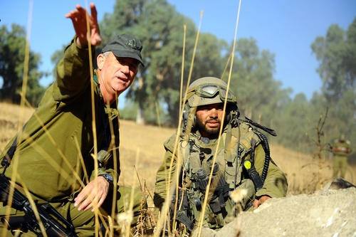"Click photo to download. Caption: On August 21, 2012, Israel Defense Forces Chief of Staff Lt. Gen. Benny Gantz visits the Golani Battalion exercise in the Golan Heights. Last month, the IDF announced that it was deploying a new division to the Syrian border in the Golan Heights to maintain ""operational readiness,"" Gantz said. Credit: Ori Shifrin, IDF Spokesperson's Unit."