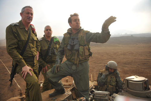"Click photo to download. Caption: On Sept. 6, 2011, IDF Chief of Staff Lt. Gen. Benny Gantz visits a company and battalion commander course exercise in the Golan Heights. Last month, the IDF announced that it was deploying a new division to the Syrian border in the Golan Heights to maintain ""operational readiness,"" Gantz said. Credit: Ori Shifrin, IDF Spokesperson's Unit."
