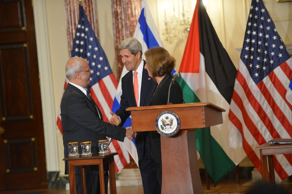 "Click photo to download. Caption: Secretary of State John Kerry, pictured here with Palestinian negotiator Saeb Erekat and Israeli negotiator Tzipi Livni, last week called it a ""mistake"" to continue to ask for Palestinian recognition of Israel as a Jewish state in efforts to reach a peace agreement. Credit: State Department."