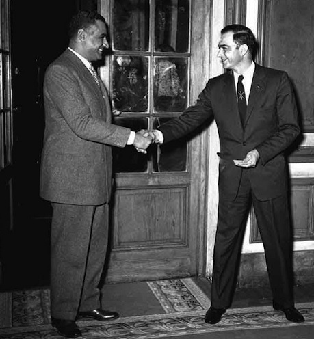 Click photo to download. Caption: Egyptian President Gamal Abdel Nasser (left) shakes hands with Henry A. Byroade, the U.S. Assistant Secretary of State for Near Eastern Affairs, in March 1955. Credit: Bibliotheca Alexandrina via Wikimedia Commons.