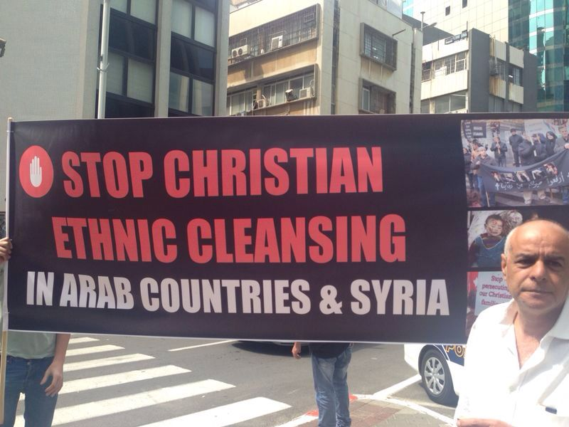 "A sign calling on the EU to help ""Stop Christian Ethnic Cleansing"" in the Middle East at the Israeli Christian Lobby's protest outside the EU Embassy in Israel on Sunday. Credit: Israeli Christian Lobby."