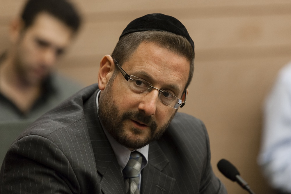 "Click photo to download. Caption: Member of Knesset Rabbi Dov Lipman (Yesh Atid) is pictured in an Immigration, Absorption and Diaspora Affairs Committee meeting in the Knesset on Nov. 19, 2013. Lipman and several other Knesset members recently introduced legislation that would make any illegitimate use of the word ""Nazi"" or Nazi symbols punishable by law. Credit: Flash90."