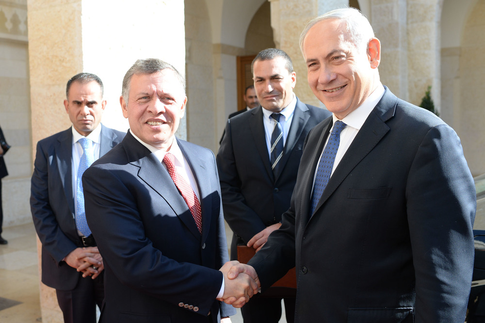 Click photo to download. Caption: Israeli Prime Minister Benjamin Netanyahu meets with Jordanian King Abdullah II at the Royal Palace in Amman, Jordan, on January 16, 2014. A recent border incident in which Israeli troops shot a Jordanian judge has highlighted the dualities of the Jewish state's stable-yet-tenuous relations with its eastern neighbor. Credit: Kobi Gideon/GPO/FLASH90.