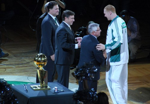 Click photo to download. Caption: Brian Scalabrine of the Boston Celtics (far right) accepts his NBA championship ring in October 2008 from then NBA commissioner David Stern. Credit: Eric Kilby via Wikimedia Commons.