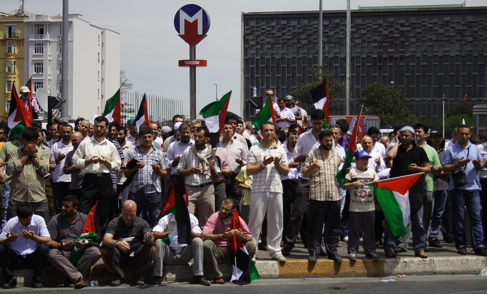 Click photo to download. Caption: Protesters in Istanbul pray before a demonstration relating to the Gaza flotilla on May 31, 2010. The flotilla incident led to the deterioration of Israel-Turkey relations. Credit: Bektour via Wikimedia Commons.