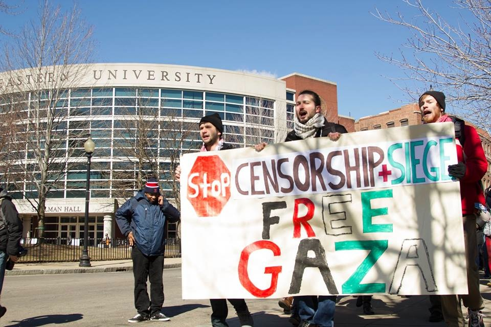 Click photo to download. Caption: In March, Students for Justice in Palestine (SJP) activists at Boston's Northeastern University protest the school's decision to suspend SJP for one academic year. Credit: Northeastern SJP Facebook page.