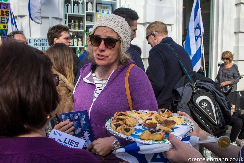 "Click photo to download. Caption: A recent event of Sussex Friends of Israel's ""Pies Against Lies"" initiative, launched to counter Boycott, Divestment and Sanctions (BDS) protests at the Israeli-owned Ecostream store in Brighton, England. Credit: Oren Teichmann/Sussex Friends of Israel."