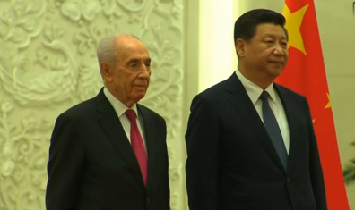 Israeli President Shimon Peres (left) on his state visit to China. Credit: Israel Hayom video screenshot.