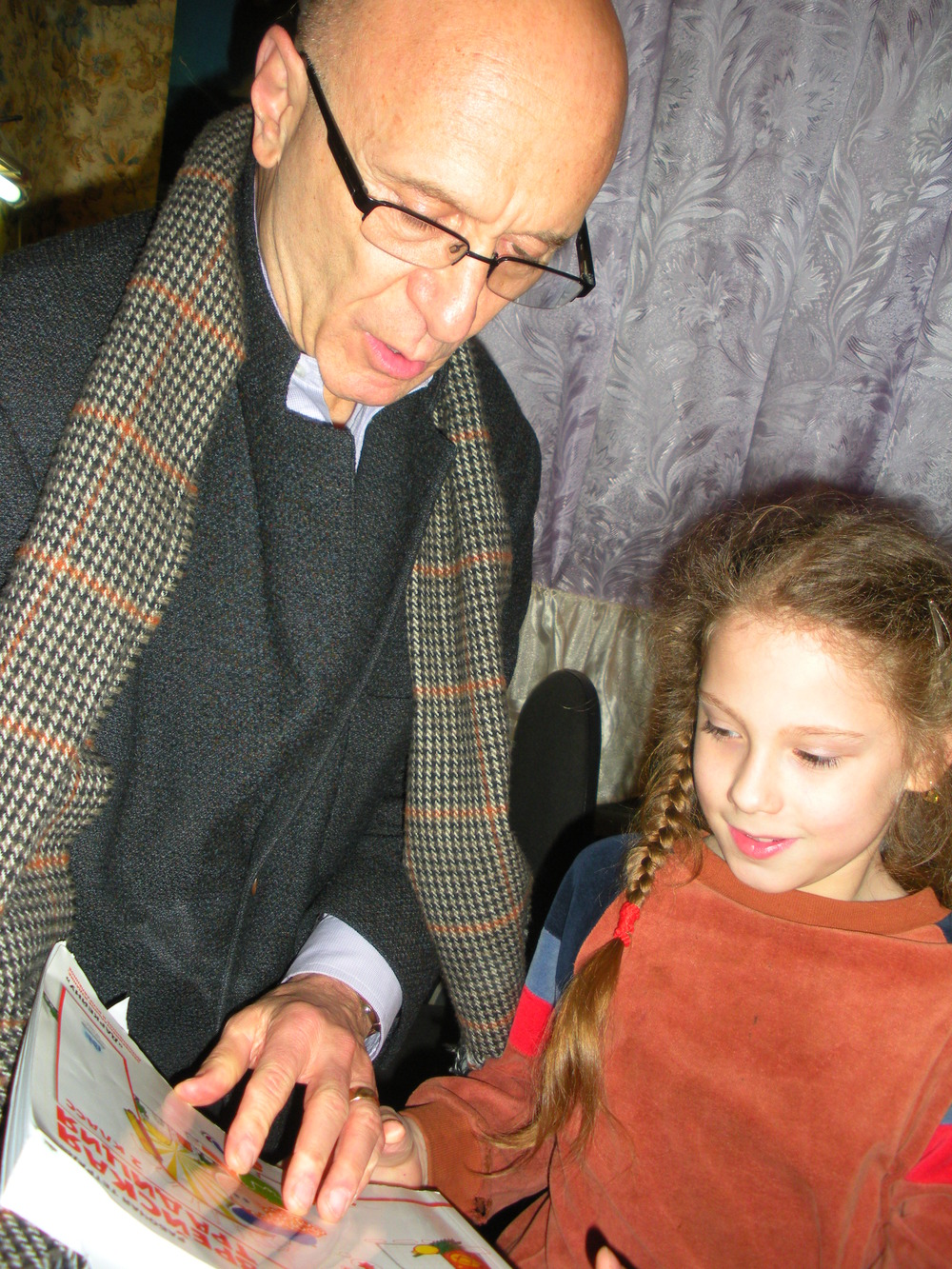 Click photo to download. Caption: In the Ukrainian city of Odessa, Lera Soroka-Krushelnitskaya, whose family receives JDC support, shares a story from her new book with JDC CEO Alan H. Gill. Credit: JDC.