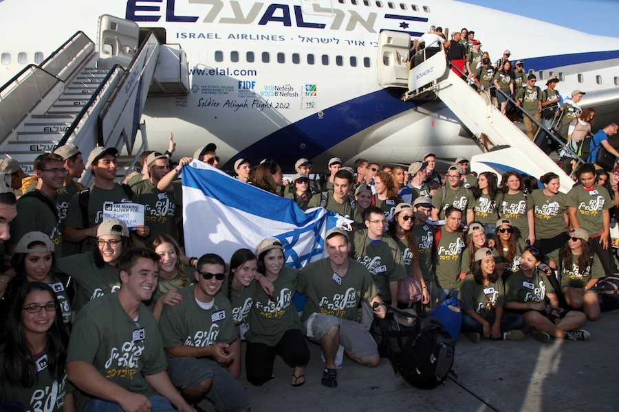 Soon-to-be IDF soldiers exiting the Nefesh B'Nefesh aliyah (immigration to Israel) flight on the runway at Ben-Gurion Airport in August 2012. Credit: Nefesh B'Nefesh.