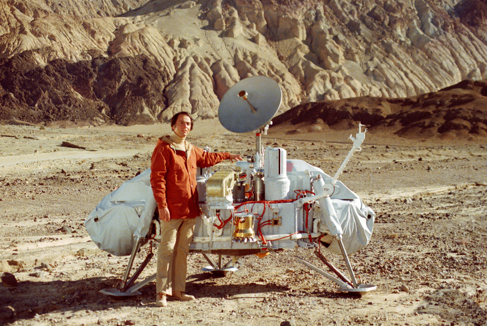 Click photo to download. Caption: Carl Sagan with a model of a NASA Viking lander. Credit: JPL via Wikimedia Commons.