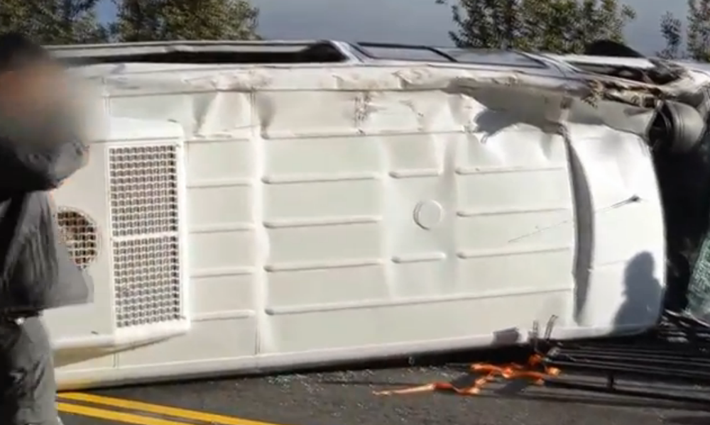 The overturned minibus used by Israeli backpackers in Argentina. Credit: Israel Hayom video screenshot.