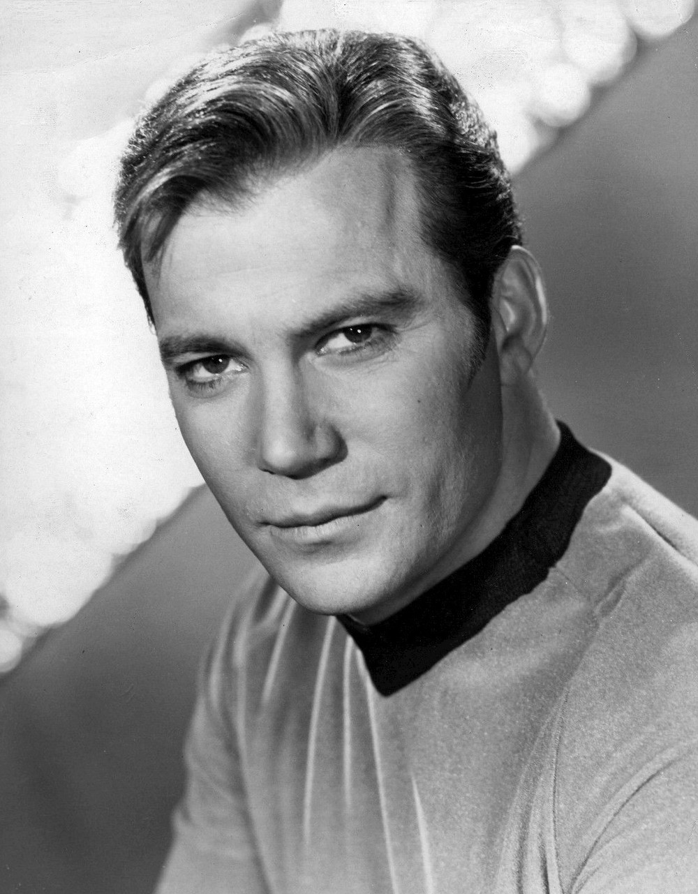 "Click photo to download. Caption: William Shatner as Captain Kirk on ""Star Trek."" Credit: NBC Television via Wikimedia Commons."