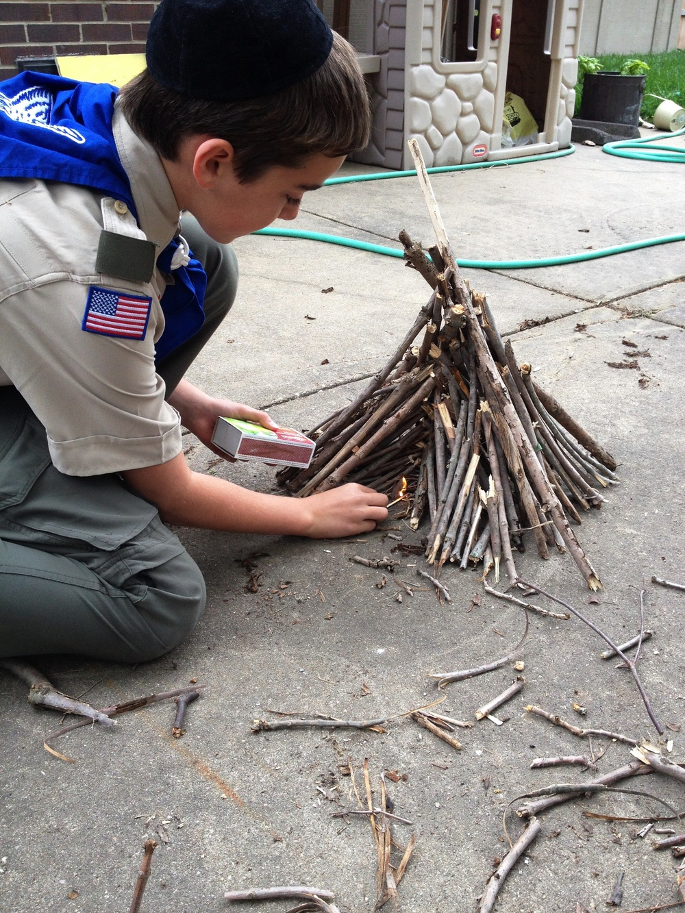 "Click photo to download. Caption: Boy Scout Abraham ""Avi"" Brudoley makes a bonfire. Pictured is step four: light it up. Credit: Maayan Jaffe."