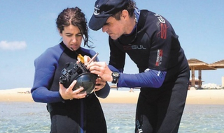 Prof. Yoav Shechner and doctoral student Marina Alterman experiment with the Stella Maris camera, which enables divers and submarines to see above the surface of the water without a periscope. Credit: Technion.