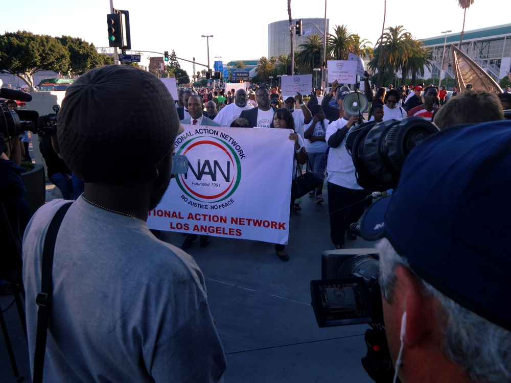 Click photo to download. Caption: National Action Network Los Angeles participants march alongside Staples Center in Los Angeles in reaction to the Donald Sterling scandal on April 29. Credit: Craig Dietrich via Wikimedia Commons.