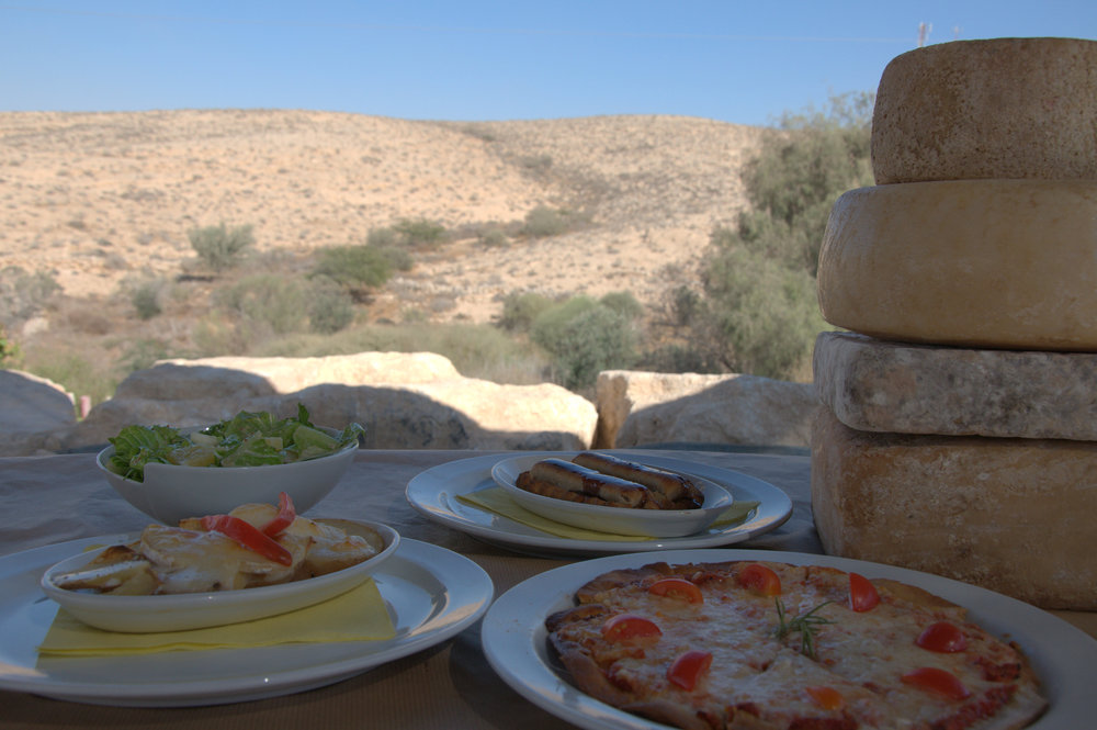 Click photo to download. Caption: At its restaurant, the Negev-based Kornmehl farm offers a cheese pizza slathered in its famous mozzarella cheese, among other dishes like those pictured here. Credit: Provided photo.