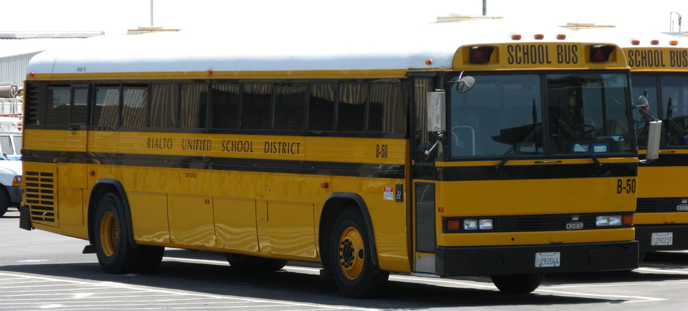 "A school bus of California's Rialto Unified School District, which said it would alter an assignment that asked eighth-grade students to write an essay about whether they believe the Holocaust actually took place or was ""merely a political scheme created to influence public emotion and gain."" Credit: Oleknutlee via Wikimedia Commons."