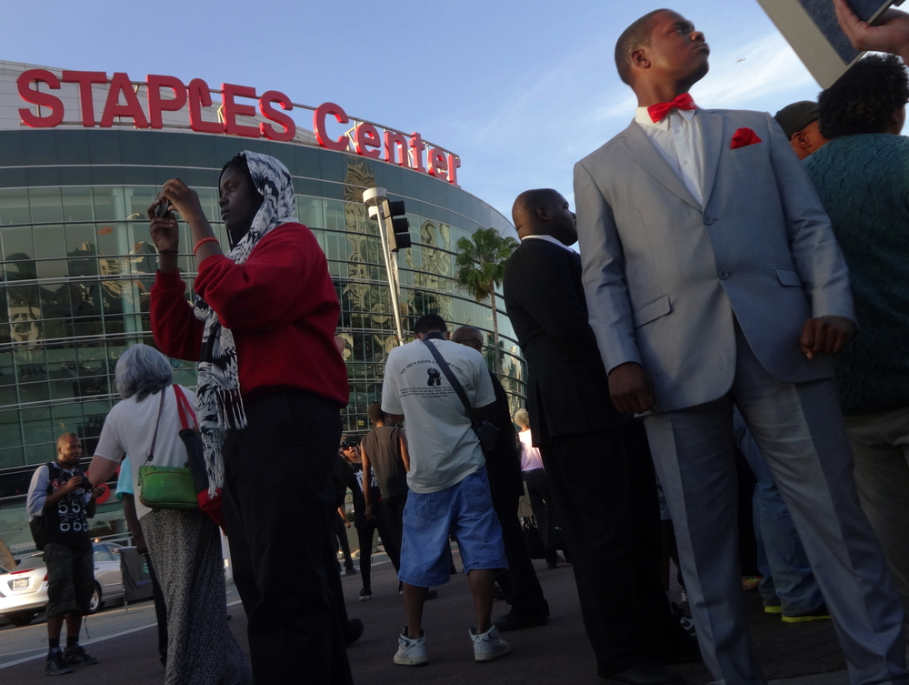 Click photo to download. Caption: A protest of Donald Sterling's racist comments next to the Staples Center, home of the Sterling-owned Los Angeles Clippers, on April 29. Credit: Craig Dietrich via Wikimedia Commons.