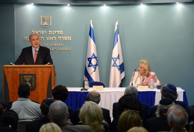 Israeli Prime Minister Benjamin Netanyahu, along with Friends of the Israel Defense Forces (FIDF) National Chairman Nily Falic, speaks to FIDF delegates in Jerusalem on Wednesday. Credit: Haim Zach.