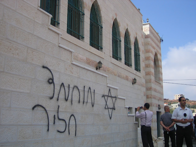 """Price tag"" vandalism on the Qusra mosque in the West Bank. Credit: Wikimedia Commons."