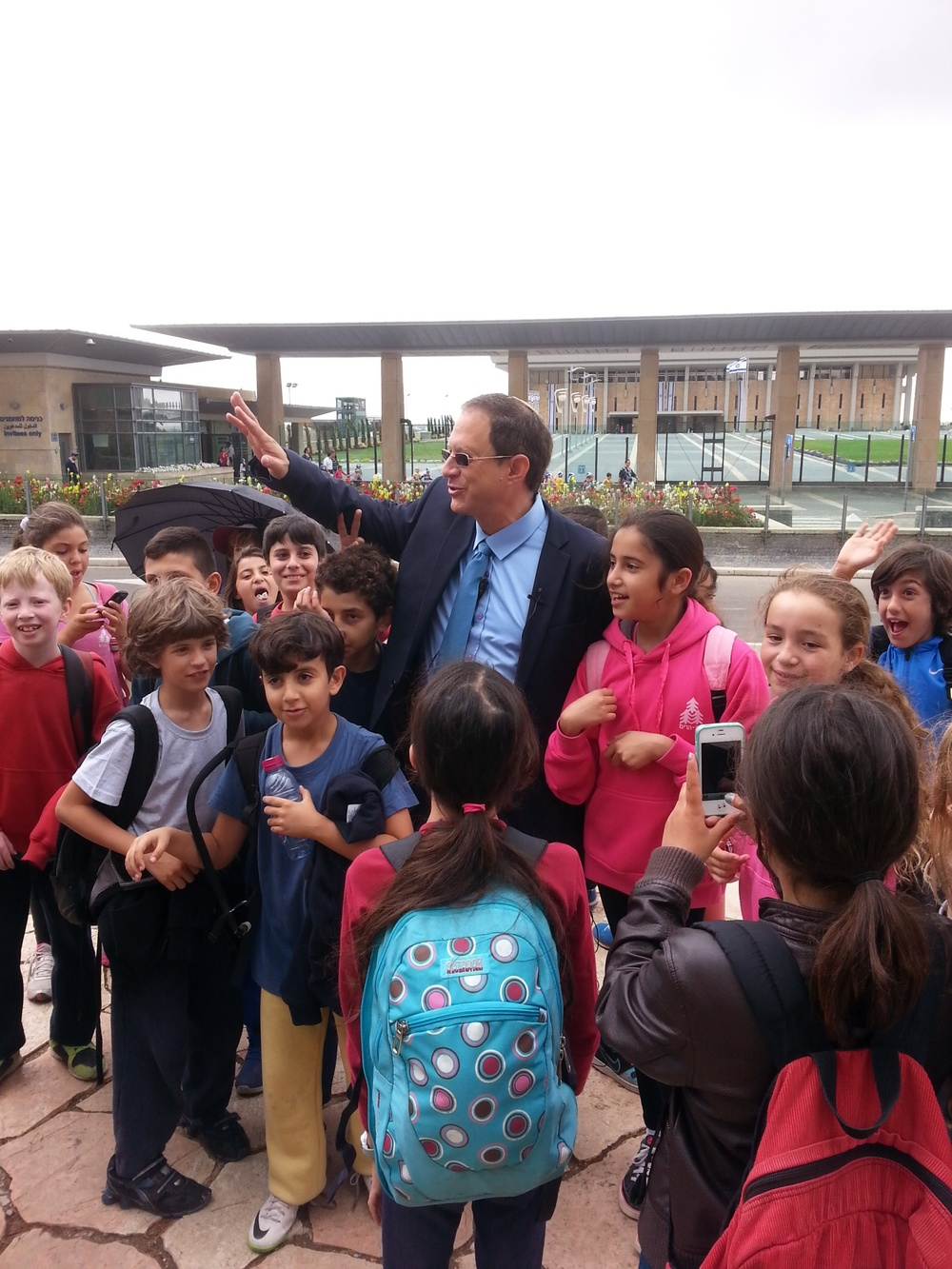 Click photo to download. Caption: Solar energy entrepreneur Yosef Abramowitz, an unexpected candidate for Israeli president, with schoolchildren in Israel. Credit: Provided photo.