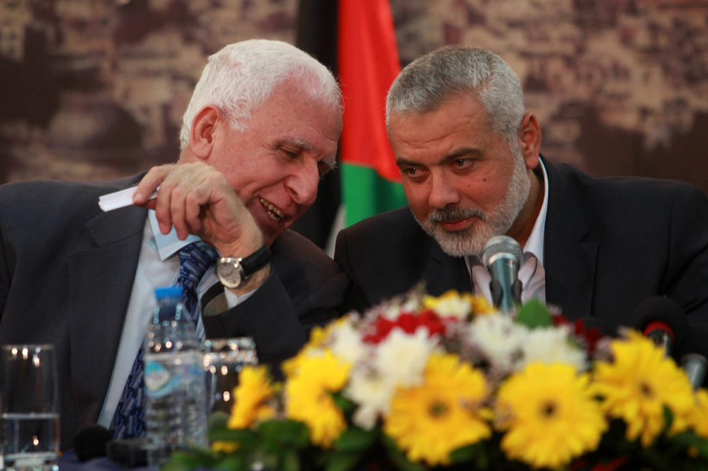 Click photo to download. Caption: Head of the Hamas government Ismail Haniyeh (right) and senior Fatah official Azzam Al-Ahmed at a news conference that announced a Palestinian reconciliation agreement in Gaza City on April 23. Amid the unity pact between Fatah and the terrorist group Hamas, and the Palestinian Authority's unilateral efforts to join international bodies and gain recognition of a Palestinian state, a growing number of respected Israeli leaders are proposing unilateral steps by Israel. Credit: Abed Rahim Khatib/Flash90.