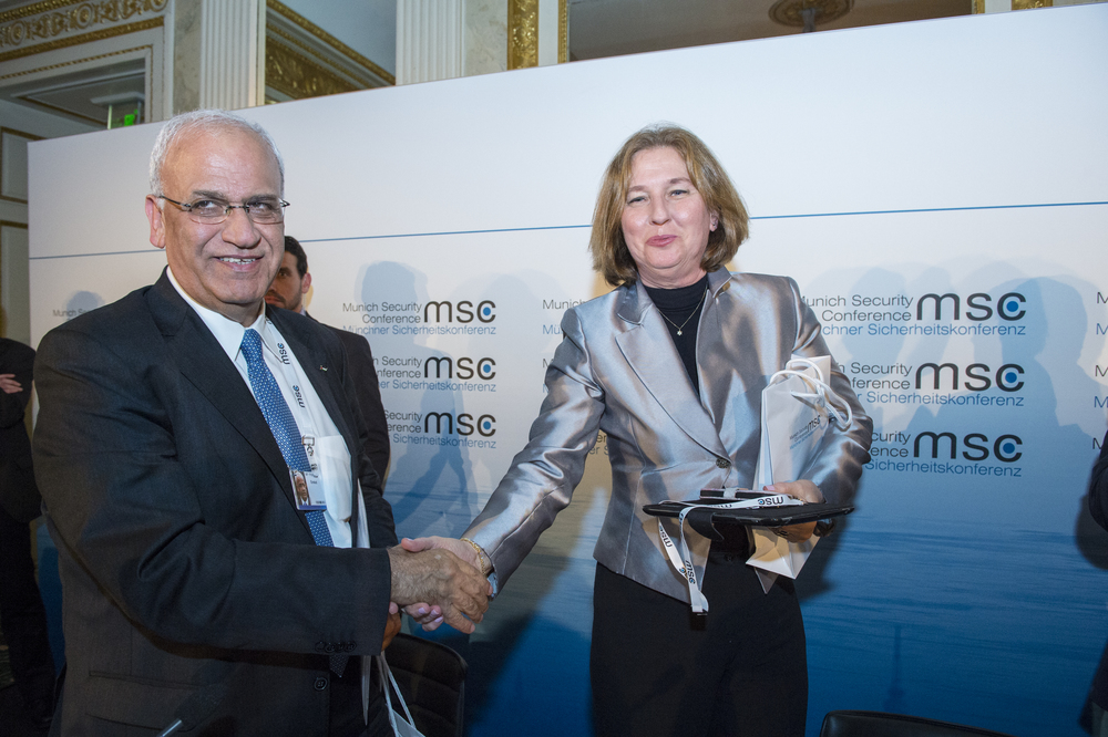 Saeb Erekat and Tzipi Livni, chief Palestinian and Israeli negotiators in the now-defunct peace talks, are pictured on Jan. 31 at the Munich Security Conference. Credit: Marc Müller via Wikimedia Commons.