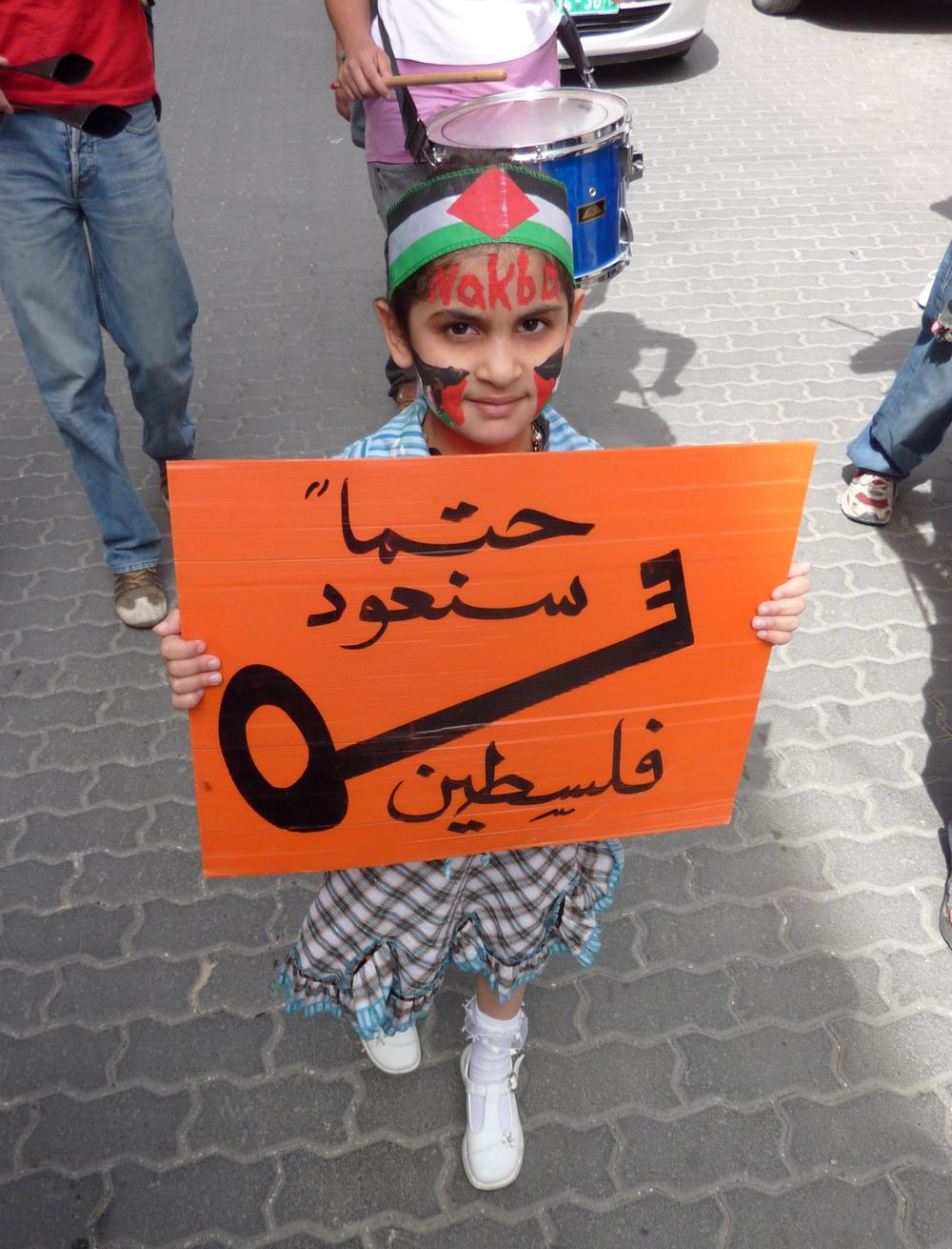 "A Palestinian girl in a protest on ""Nakba Day"" 2010 in Hebron. Credit: Shy Halatzi via Wikimedia Commons."