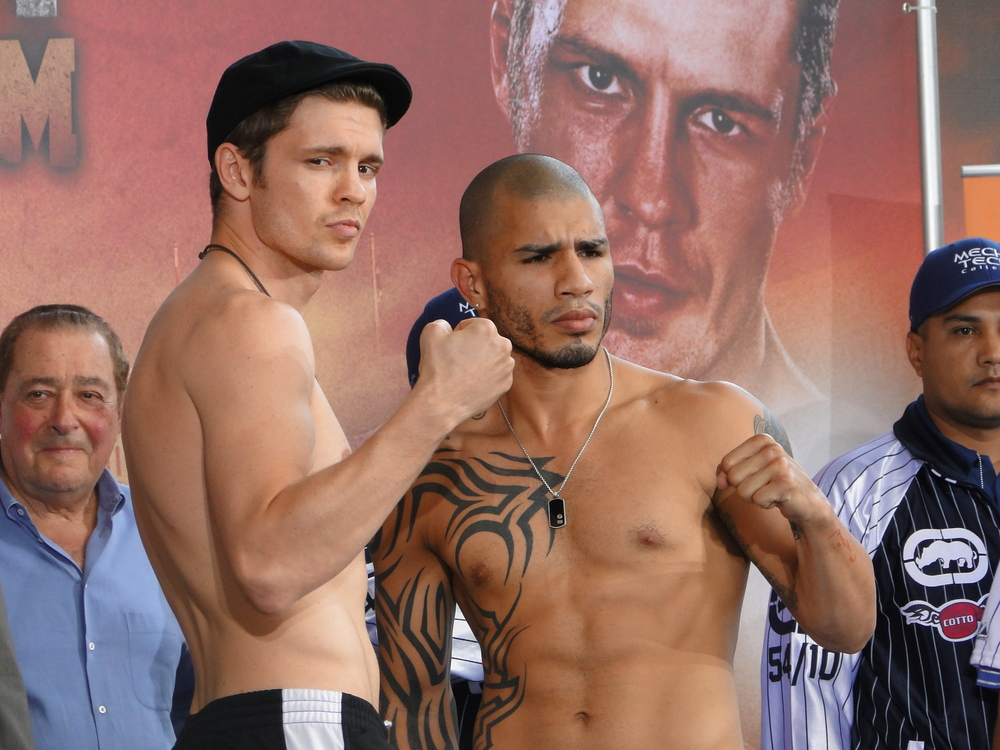 Yuri Foreman (left) and Miguel Cotto at their official weigh-in on June 4, 2010. Foreman would lose the fight, and his world championship, the next day. Credit: Chamber of Fear via Wikimedia Commons.