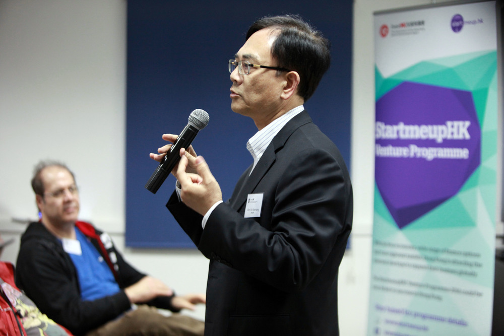 Click photo to download. Caption: Allen Ma, Hong Kong Science and Technology Parks Corporation, speaks at a program of Invest Hong Kong (InvestHK) in Israel this week. InvestHK led a 31-member delegation from Hong Kong to Israel for the MIXiii - Israel Innovation Conference 2014. At right is a poster for InvestHK's global StartmeupHK Venture Programme competition, which aims to help innovative ventures launch and develop their global businesses throughout Hong Kong. The 2014 competition kicked off on May 19. Credit: InvestHK.