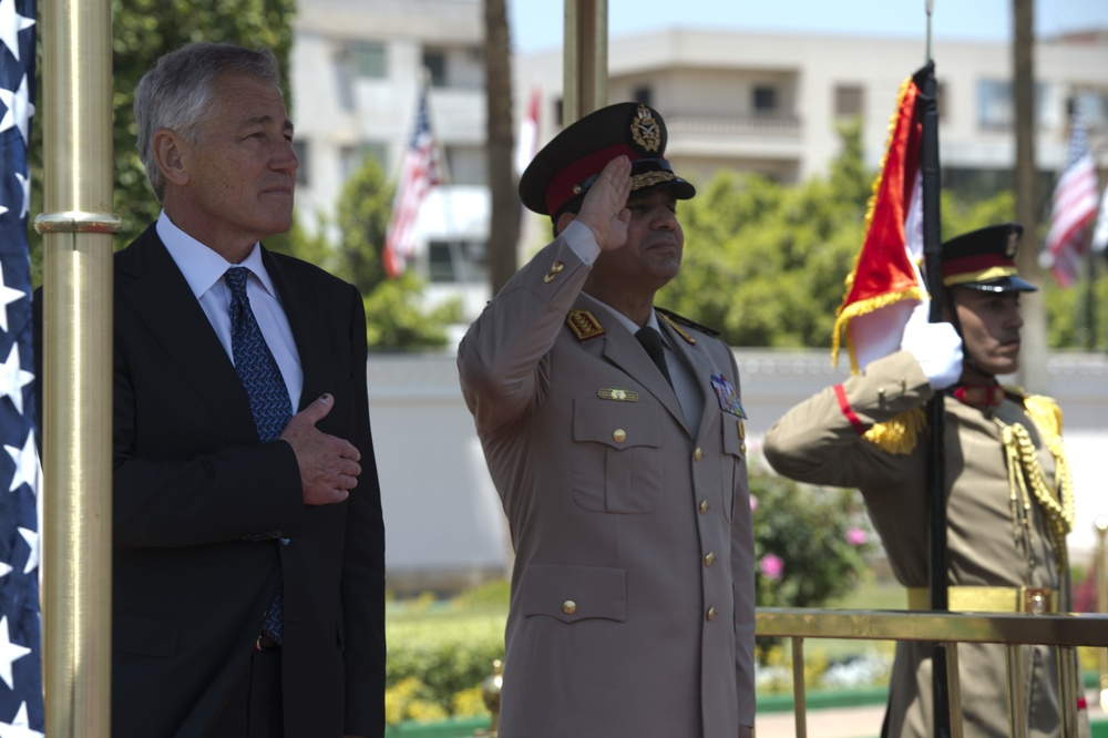 Click photo to download. Caption: U.S. Secretary of Defense Chuck Hagel (left) participates in an arrival honors ceremony with Abdel Fattah El-Sisi (center), then the Egyptian Minister of Defense, in Cairo on April 24, 2013. Credit: Erin A. Kirk-Cuomo/Secretary of Defense via Wikimedia Commons.