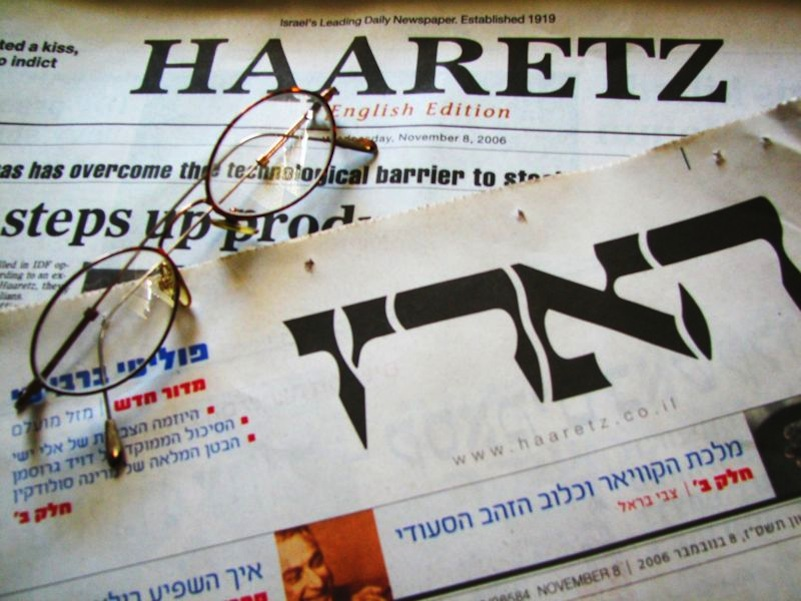 Click photo to download. Caption: English and Hebrew editions of the Israeli newspaper Haaretz. Sometimes in a dramatic fashion, and other times subtly, information that first appeared in the Haaretz Hebrew edition regarding Palestinian or Arab terrorism, extremism or other wrongdoing is either downplayed or omitted entirely, at times to the point of being completely at odds with the original Hebrew text. Credit: Hmbr via Wikimedia Commons.