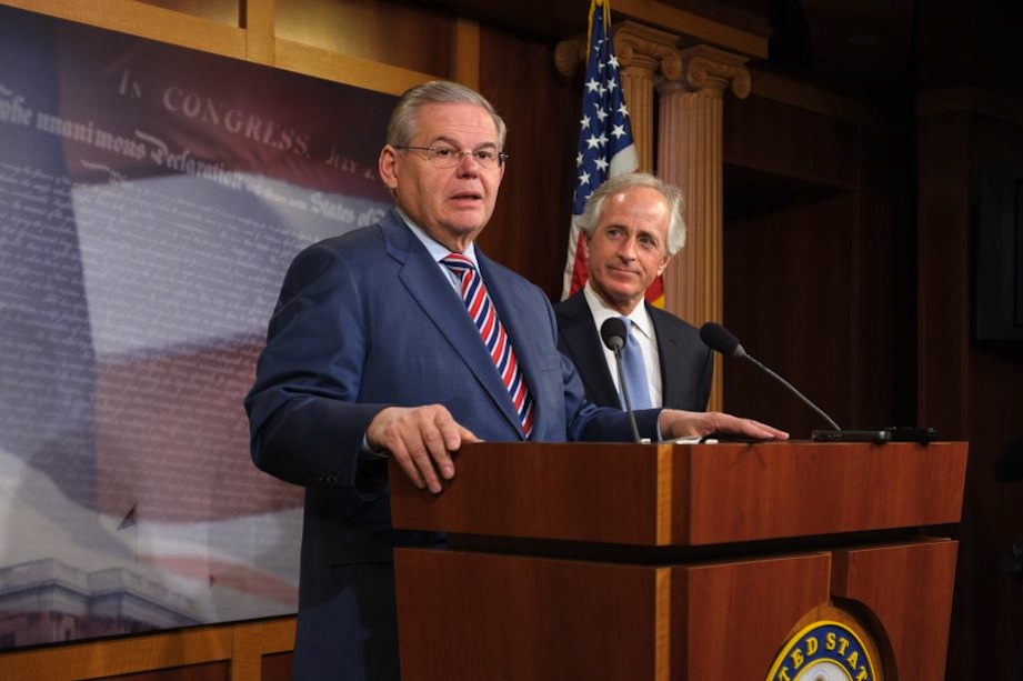 Click photo to download. Caption: Sen. Robert Menendez (D-N.J.) speaks at a press conference in March that followed the Senate's passage of a bill on Ukraine. Looking on is Sen. Bob Corker (R-Tenn.), whose amendment proposing congressional oversight of a deal on the Iran nuclear program this month prompted Menendez, chair of the Senate Foreign Relations Committee, to withdraw the U.S.-Israel Strategic Partnership Act of 2013. Credit: Office of Sen. Robert Menendez.
