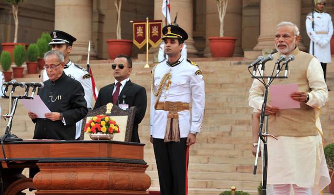 Click photo to download. Caption: Narendra Modi (far right) is sworn in as prime minister of India onMay 27, 2014. Credit:Narendra Modi via Wikimedia Commons.