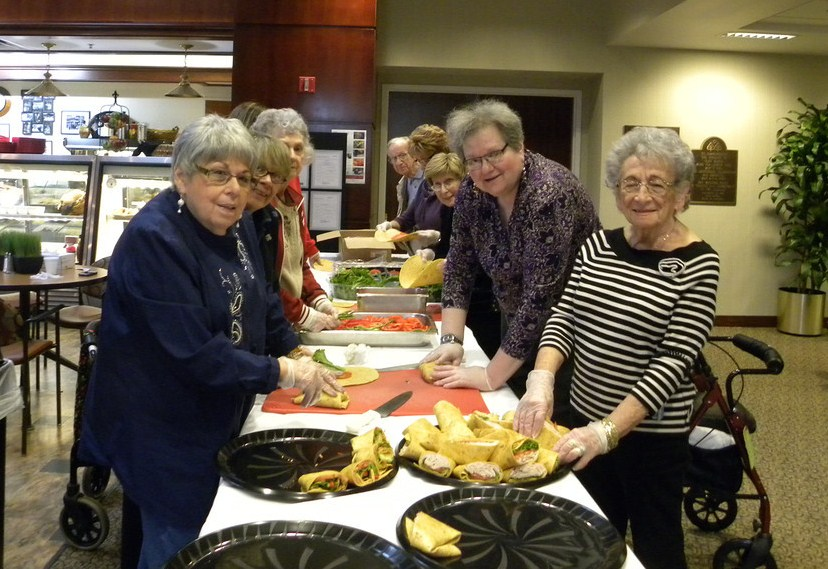 "Click photo to download. Caption: ""Chesed Corps"" volunteers of the Cedar Village Retirement Community in Mason, Ohio, make sandwich wraps at Cedar Village in April 2014, a day before serving lunch at the Ronald McDonald House in Cincinnati. Credit: Cedar Village Retirement Community."