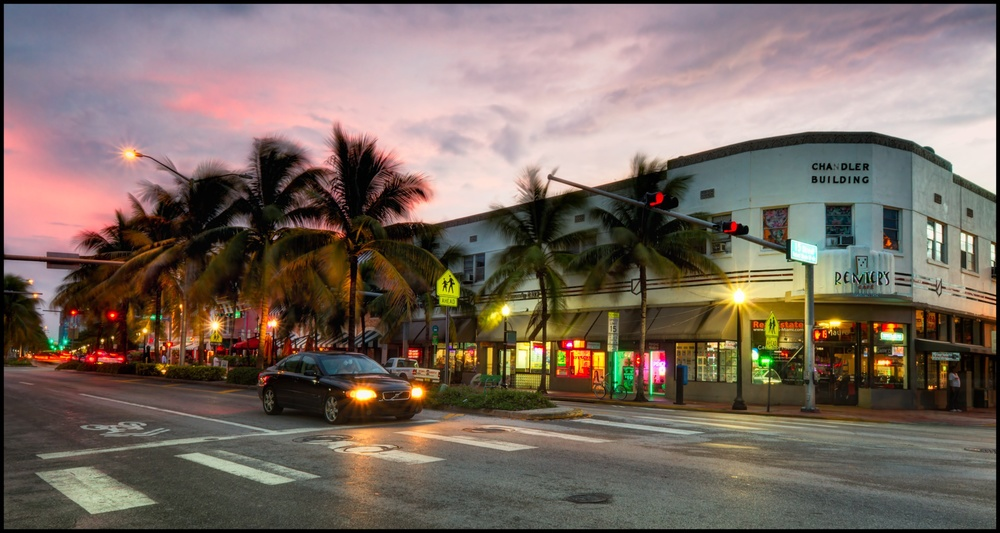 Click photo to download. Caption:A view of Washington Ave and 15th Street in South Beach, Miami. Rather than the partying/nightlife destination it is known as today, South Beach used to be a prime spot for Jewish seniors. Credit:Pedro Szekely via Wikimedia Commons.