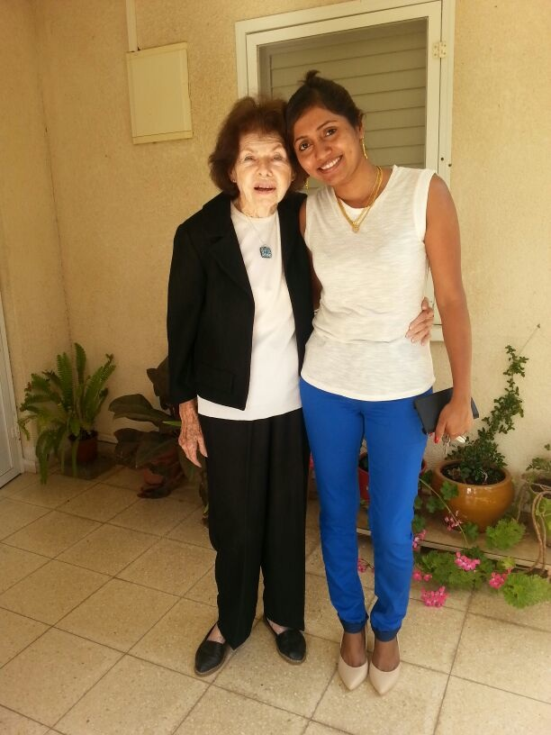 "Click photo to download. Caption:  Janet Tauro (right), a foreign worker from Mumbai, is the caretaker for Varda Kahanovich (left), a 90-year-old Israeli woman living on Kibbutz Maagan Michael. ""Today the foreign caregiver that lives with the patient—this is the most common way to grow old in Israel,"" says Yaron Bengera, vice president of Yad Beyad, a Tel Aviv-based agency that recruits foreign workers. Credit: Provided photo."