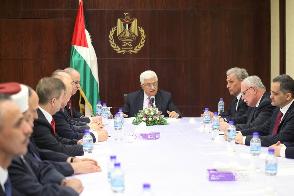 Click photo to download. Caption: Palestinian Authority President Mahmoud Abbas (center) meets with the new Fatah-Hamas unity government in the West Bank city of Ramallah on June 2, 2014. Credit: Issam Rimawi/Flash90.