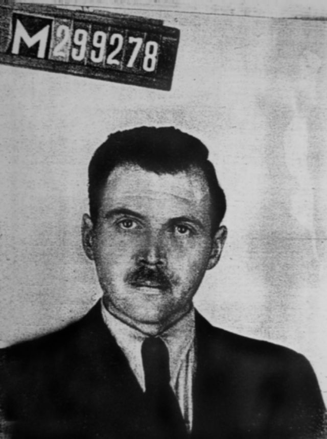Click photo to download. Caption: A photo taken by a police photographer in 1956 in Buenos Aires for Josef Mengele's Argentine identification document. Credit: Wikimedia Commons.