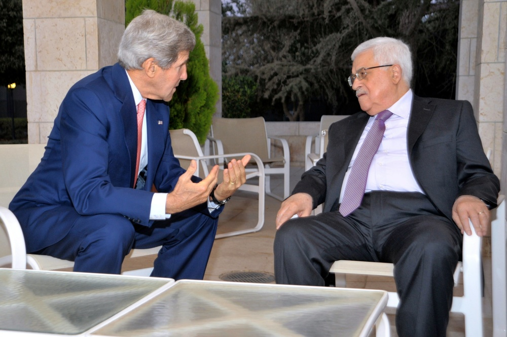 U.S. Secretary of State John Kerry sits with Palestinian Authority President Mahmoud Abbas before they meet and celebrate iftar, the breaking of the daily fast during the Islamic holy month of Ramadan, in Amman, Jordan, on July 16, 2013. Credit: U.S. Department of State.